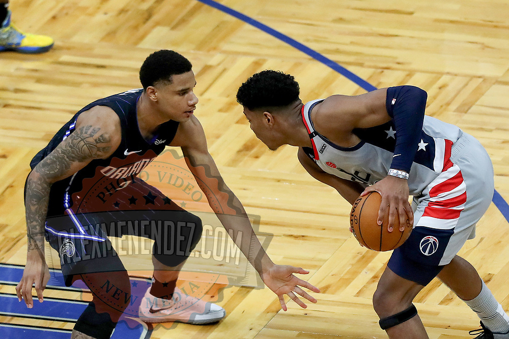 ORLANDO, FL - APRIL 07: Chuma Okeke #3 of the Orlando Magic defends against Rui Hachimura #8 of the Washington Wizards at Amway Center on April 7, 2021 in Orlando, Florida. NOTE TO USER: User expressly acknowledges and agrees that, by downloading and or using this photograph, User is consenting to the terms and conditions of the Getty Images License Agreement. (Photo by Alex Menendez/Getty Images)*** Local Caption *** Chuma Okeke; Rui Hachimura