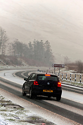 © Licensed to London News Pictures. 12/03/2020. Brecon Beacons, Powys, Wales, UK.  Motorists drive along the A470 road in wintry conditions in the Brecon Beacons National Park, Powys, Wales, UK. Photo credit: Graham M. Lawrence/LNP