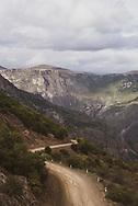 A dirt road winds through the Caucasus Mountains near Tatev Monastery in Armenia.