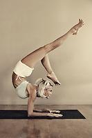 Pretty woman in yoga pose.