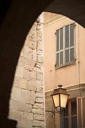 Arch and window of old town citadel, Bonifacio, Corsica, France