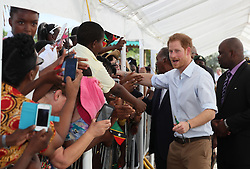Prince Harry meets local residents after arriving at Charlestown Dock on the island of Nevis for the second leg of his Caribbean tour.