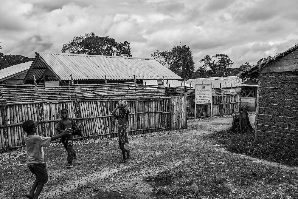 KIds play football by the Community Health Centre, John Logan Town. Liberia.