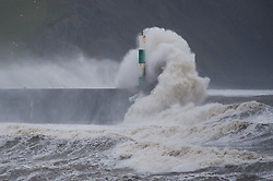© London News Pictures. 05/12/2015 Aberystwyth, Wales, UK. The fourth named storm of the season, Storm Desmond, picks up strength and begins to batter the coast at Aberystwyth, west Wales.The Met Office has issued yellow warnings for the gale force winds,  with gusts of up to 70mph in places on the Irish Sea coast.. Photo credit: Keith Morris/LNP