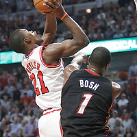 14 March 2012: Chicago Bulls guard Jimmy Butler (21) goes to the basket past Miami Heat power forward Chris Bosh (1) during the Chicago Bulls 106-102 victory over the Miami Heat at the United Center, Chicago, Illinois, USA.