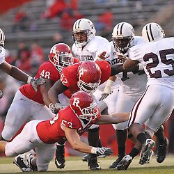 Oct 10, 2009; Piscataway, NJ, USA; Texas Southern running back Martin Gilbert (25) evades the reaching arms of Rutgers defenders during second half NCAA college football action in Rutgers' 42-0 victory over Texas Southern at Rutgers Stadium.