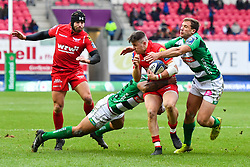Scarlets' Steff Evans is tackled by Tommaso Benvenuti and Benetton Treviso's Angelo Esposito - Mandatory by-line: Craig Thomas/JMP - 09/12/2017 - RUGBY - Parc y Scarlets - Llanelli, Wales - Scarlets v Benetton Rugby - European Rugby Champions Cup