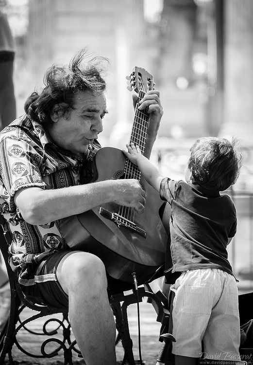 The guitarist and the little boy.