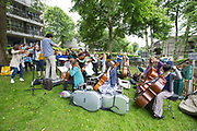 London Street Orchestra at Central Hill event, Open Garden Estates, organised by ASH Architects for Social Housing at Central Hill Estate on 18th June 2016 in South London, United Kingdom. Central Hill is a low-rise estate of more than 450 homes in Crystal Palace in South London and has been recommended for demolition under Lambeth Council estate regeneration plan. The housing scheme, built between 1966 and1974, was designed by Rosemary Stjernstedt under Lambeth Council's director of architecture, Ted Hollamby.