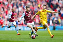 Jack Grealish of Aston Villa is challenged by Jordan Henderson of Liverpool - Photo mandatory by-line: Rogan Thomson/JMP - 07966 386802 - 19/04/2015 - SPORT - FOOTBALL - London, England - Wembley Stadium - Aston Villa v Liverpool - FA Cup Semi Final.