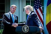 President Donald Trump shakes hands with Klaus Iohannis, Romania's president, during a joint press conference in the Rose Garden at the White House in Washington, District of Columbia, U.S., on Friday, June 9, 2017. Trump and Iohannis will discussed the 20-year-old strategic partnerships that the two countries have.