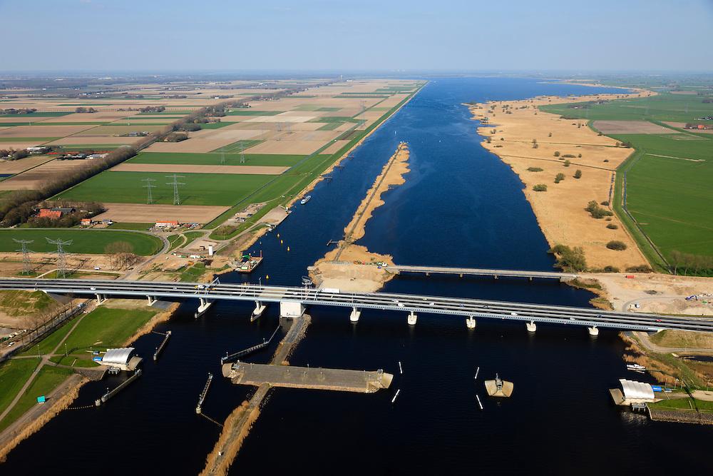 Nederland, Flevoland-Overijssel, Ramspol, 01-05-2013; nieuwe Ramspolbrug in de N50 gezien in oostelijke richting met voor de brug de balgstuw, links Flevoland, rechts Overijssel.  De vaargeul in het Ramsdiep met strekdam. Ramspol, inflatable dike, between Ketelmeer and Black Water. The Balgstuw (bellow barrier) is a storm barrier and consists of an inflatable dam or dyke, composed of three bellows. Usually, each bellow rests on the bottom of the water, but now the bellows are inflated  because of maintenance. luchtfoto (toeslag op standard tarieven)<br /> aerial photo (additional fee required)<br /> copyright foto/photo Siebe Swart<br /> luchtfoto (toeslag op standard tarieven)<br /> aerial photo (additional fee required)<br /> copyright foto/photo Siebe Swart