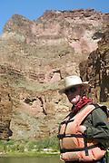 Tom Sosnowski (model release on file) standing on a raft, Colorado River, Grand Canyon National Park, Arizona, US