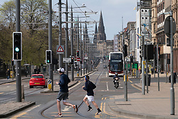 Edinburgh, Scotland, UK. 18 April 2020. Views of empty streets and members of the public outside on another Saturday during the coronavirus lockdown in Edinburgh. A very quiet Princes Street with little traffic. Iain Masterton/Alamy Live News