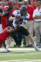 15 September 2012:  Sam Hendricks hit by Tevin Allen during an NCAA football game between the Eastern Illinois Panthers and the Illinois State Redbirds at Hancock Stadium in Normal IL