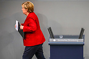 German Chancellor Angela Merkel leaves after she addressed latest developments in Afghanistan during a session at Germany's lower house of parliament the Bundestag  in Berlin, Germany, August 25, 2021. Among the issues discussed was the deployment of the German Armed Forces, Bundeswehr to oversee the evacuation from Afghanistan.