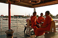 Monks on Chao Phrya River Ferry - n Bangkok, the Chao Phraya is a major transportation artery for a vast network of ferries and water taxis, also known as longtails. More than 15 boat lines operate on the river and canals of the city, including commuter ferry lines.