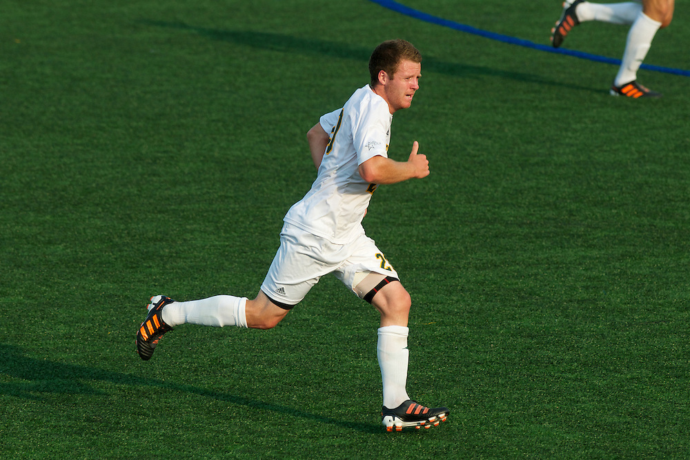 Catamounts midfielder Jonny Bonner (20) runs down the field during the men's soccer game between the Central Connecticut State University Blue Devils and the Vermont Catamounts at Virtue Field on Friday afternoon September 7, 2012 in Burlington, Vermont.