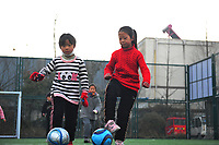 Junior Women's football team train in cold weather to raise sports spirit in Suining County, Xuzhou City, east China's Jiangsu Province, 14 January 2021. The activity have the children enjoy the happiness of football and cultivate the spirit of sports at the same time.