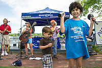 """With the band playing """"Send Me On My Way"""" Greyson Rule and Makenna Bowen from Merrimack join in the fun at Hesky Park during the Make A Wish event on Saturday afternoon.  Makenna's wish of going to Disney will be granted in October.   (Karen Bobotas/for the Laconia Daily Sun)"""