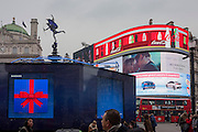 A wide scene of the Eros statue and a kissing couple appearing in an ad in Piccadilly Circus, on 15th December 2016, in London, England. (Photo by Richard Baker / In Pictures via Getty Images)