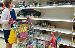© Licensed to London News Pictures. 20/09/2020. London, UK. A shopper wearing a face covering stands next to nearly empty shelves of pasta in a Sainsbury's supermarket in London, as essential items start to run out, amid a possible second lockdown due to a rise in COVID-19 cases. Photo credit: Dinendra Haria/LNP