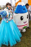 Mascot Wedding Bride -  Japanese celebrate the silly, eccentric and adorable like no other country.  Its obsession with the yuru-kyara mascots is a perfect example of this.  These mascots represent products, teams, museums, schools, prisons, branches of the military, organizations  and even the national tax office.   Most towns, counties, and companies have their own yuru-kyara mascot, following this craze. Creepy or cute, they lurk around street fairs, community events, train stations and tourist destinations.  There are large Mascot Summits such as the one in Hanyu, Saitama held every year where mascots campaign and are voted on.  Mascots normally represent local culture or products. They may be created by local government or other organizations to stimulate tourism and economic development, or created by a company to build on their corporate identity. They may appear as costumed lovable characters at promotional events and festivals meant to convey affection for one's hometown or region.