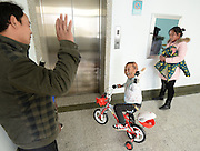 WUHAN, CHINA - NOVEMBER 16: (CHINA OUT) <br /> <br /> 3D-Printed Hand Completed<br /> <br /> A child wears 3D-printed hand while waving hand to father at Wuhan Third Hospital on November 16, 2015 in Wuhan, Hubei Province of China. A child, a farmer Liu Tao\'s son, fell into a fiery pit where straws was burning when he was only three years old. Left ear and left hand got injured heavily that the left hand had to be cut. While a phone in May this year from Wuhan Third Hospital gave them hope that the lost left hand could be replaced by 3D-printed hand and luckily it made success on the child finally.<br /> ©Exclusivepix Media