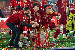 LIVERPOOL, ENGLAND - Wednesday, July 22, 2020: Liverpool's elite development coach Vitor Matos, Harvey Elliott, Neco Williams and Curtis Jones celebrate with the Premier League trophy as the Reds are crowned Champions after the FA Premier League match between Liverpool FC and Chelsea FC at Anfield. The game was played behind closed doors due to the UK government's social distancing laws during the Coronavirus COVID-19 Pandemic. Liverpool won 5-3. (Pic by David Rawcliffe/Propaganda)