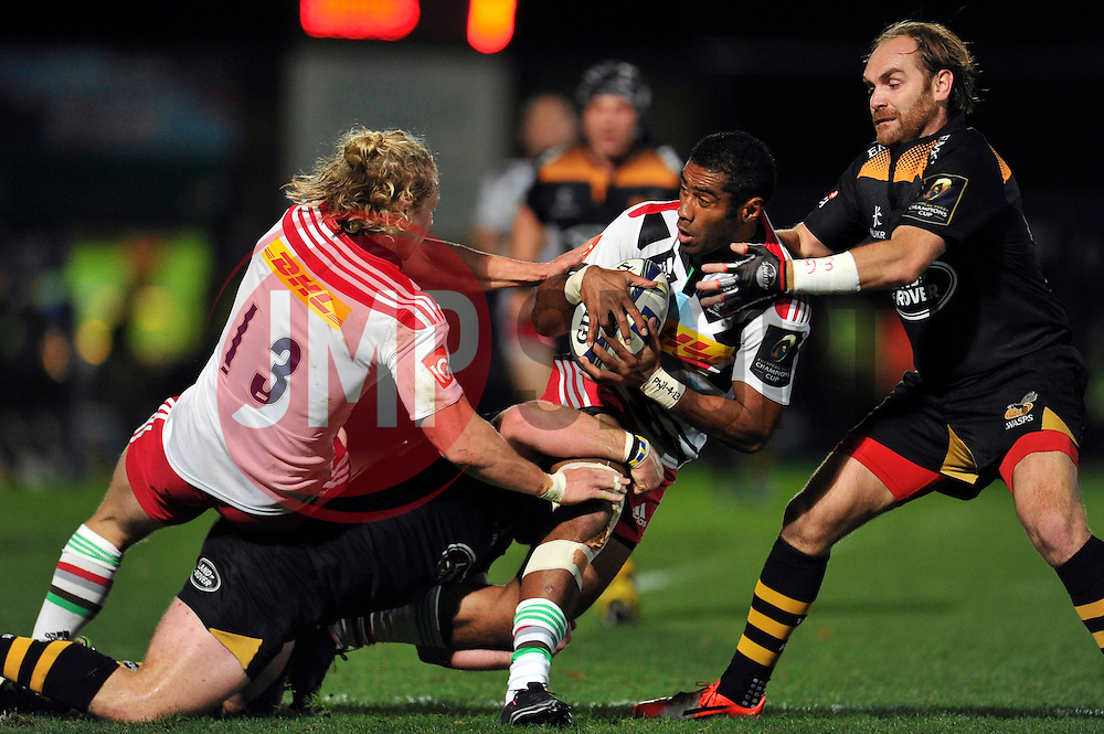 Aseli Tikoirotuma of Harlequins is tackled - Photo mandatory by-line: Patrick Khachfe/JMP - Mobile: 07966 386802 26/10/2014 - SPORT - RUGBY UNION - High Wycombe - Adams Park - Wasps v Harlequins - European Rugby Champions Cup