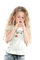 caucasian little girl portrait drinking milk isolated studio on white background