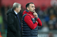 Leon Britton, the Swansea city caretaker manager looks on.  Premier league match, Swansea city v Crystal Palace at the Liberty Stadium in Swansea, South Wales on Saturday 23rd December 2017.<br /> pic by  Andrew Orchard, Andrew Orchard sports photography.