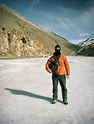 Photographer Matthieu Paley standing on the frozen Wakhan river, on the trek up to the Little Pamir mountains, the North East extremity of Afghanistan.