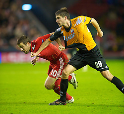LIVERPOOL, ENGLAND - Wednesday, December 15, 2010: Liverpool's Joe Cole and FC Utrecht's Jan Wuytens during the UEFA Europa League Group K match at Anfield. (Photo by: David Rawcliffe/Propaganda)