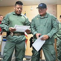 Sergeant Mark Spencer (left),  presents Officer Francis Collins with the Hard Charger Award for showing leadership, motivation and expertise during the Gallup Police Emergency Response Training swat course at a ceremony at the Gallup Police Department Tuesday, Oct. 30.