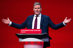 © Licensed to London News Pictures. 29/09/2021. Brighton, UK. SIR KEIR STARMER , his face obscured by stage furniture , delivers the leader's speech at the close of the conference . The final day of the 2021 Labour Party Conference , which is taking place at the Brighton Centre . Photo credit: Joel Goodman/LNP