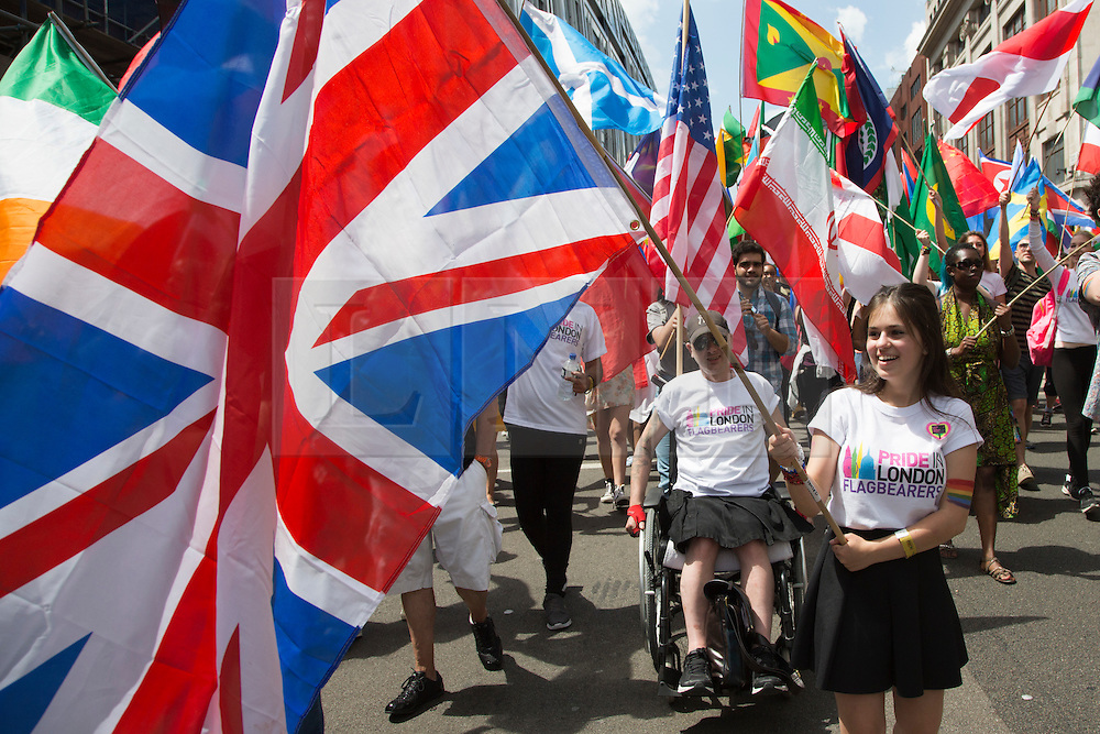 © Licensed to London News Pictures. 27/06/2015. London, UK. 220 flags of the world were carried at the start of the parade, Sasha, 17, carried the Union Flag. The LGBT Pride in London Parade takes place in Central London. Photo credit: Bettina Strenske/LNP