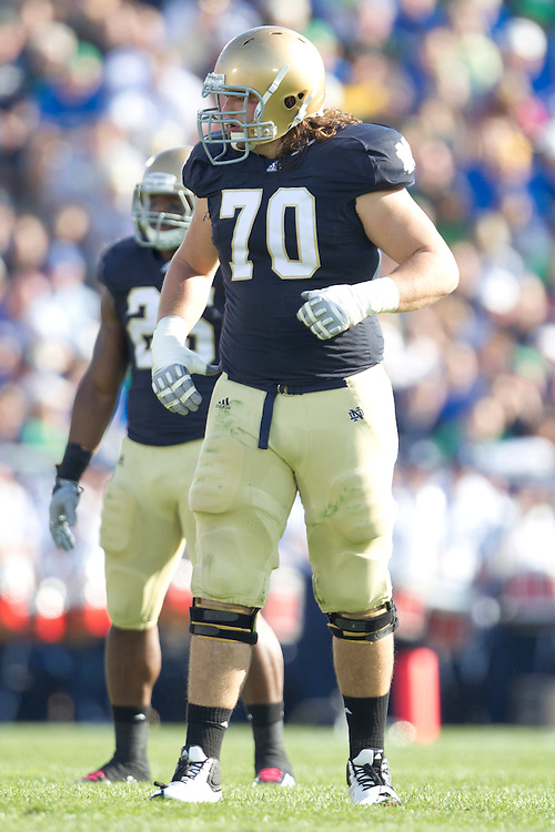 Notre Dame offensive tackle Zack Martin (#70) in action during NCAA football game between Notre Dame and Air Force.  The Notre Dame Fighting Irish defeated the Air Force Falcons 59-33 in game at Notre Dame Stadium in South Bend, Indiana.
