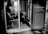 Sexual masseuse in her tiny shop which is decorated to look like a hair salon beside one of the canals that make the region famous on the fringes of Hangzhou, China.