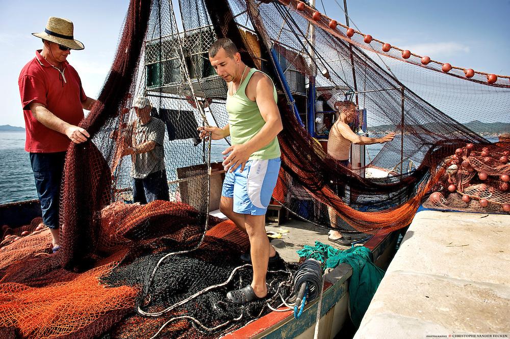 Zadar, Croatia, Jun 16, 2010, Fishermen having a check-up of their materials.