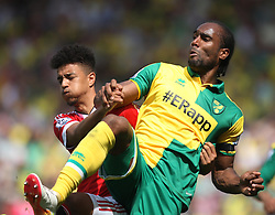 Cameron Jerome of Norwich City (R) and Cameron Borthwick-Jackson of Manchester United in action - Mandatory by-line: Jack Phillips/JMP - 07/05/2016 - FOOTBALL - Carrow Road - Norwich, England - Norwich City v Manchester United - Barclays Premier League