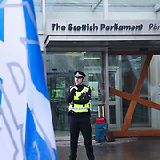 The day after the refefrendum a small group of YES campaigner meet outside Parliament with police keeping an eye. Scottish referendum in Edinburgh.