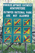 Greece, Macedonia, Mount Olympus National Park Sign prohibiting hunting camping swimming and picking flowers