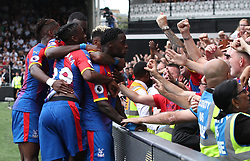 """Crystal Palace's Jeffrey Schlupp (centre) celebrates scoring his side's first goal of the game with team-mate during the Premier League match at Craven Cottage, London. PRESS ASSOCIATION Photo. Picture date: Saturday August 11, 2018. See PA story SOCCER Fulham. Photo credit should read: Yui Mok/PA Wire. RESTRICTIONS: EDITORIAL USE ONLY No use with unauthorised audio, video, data, fixture lists, club/league logos or """"live"""" services. Online in-match use limited to 120 images, no video emulation. No use in betting, games or single club/league/player publications.during the Premier League match at Molineux, Wolverhampton. PRESS ASSOCIATION Photo. Picture date: Saturday August 11, 2018. See PA story SOCCER Wolves. Photo credit should read: Nick Potts/PA Wire. RESTRICTIONS: EDITORIAL USE ONLY No use with unauthorised audio, video, data, fixture lists, club/league logos or """"live"""" services. Online in-match use limited to 120 images, no video emulation. No use in betting, games or single club/league/player publications."""
