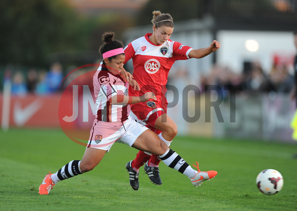 Bristol Academy Womens' Loren Dykes gets tackled by a Notts County player. - Photo mandatory by-line: Alex James/JMP - Mobile: 07966 386802 - 04/10/2014 - SPORT - Football - Bristol - Stoke Gifford Stadium - Bristol Academy Womens v Notts County Ladies - Womens Super League