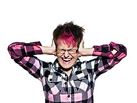 Portrait of a cool young woman screaming while covering ears isolated on white background