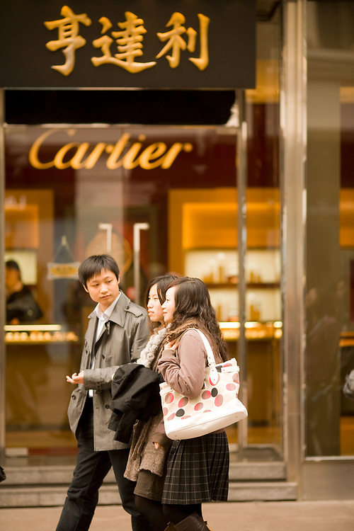 Shanghai, Huangpu district, China, Asia - Modern Chinese youth in front a Cartier store shopping at Nanjing Road, a mayor commercial street in Shanghai.