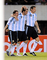ARGENTINA (2) Vs. PERU (1) in a soccer match for the South American qualification for the FIFA 2010 World Cup.<br /> Buenos Aires, Argentina October 10, 2009/<br /> GONZALO HIGUAIN celebrating after his goal with LIONEL MESSI (L) and MARTIN PALERMO (R).<br /> Palermo did the secong goal for Argentina.<br /> © PikoPress