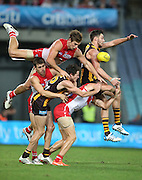 Dane Rampe ,Nick Malceski of the Swans and Isaac Smith of the Hawks cotest a mark during the 2014 AFL Round 08 match between the Sydney Swans and the Hawthorn Hawks at ANZ Stadium, Sydney on May 09, 2014. (Photo: Craig Golding/AFL Media)