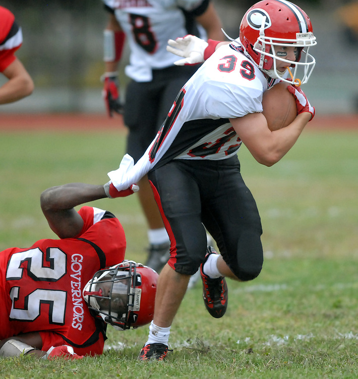 10/2/09 2Cheshire<br /> ML0585C<br /> Wilbur Cross High School, New Haven, 2nd quarter: Cross' E.J. Murray left brings down Cheshire's Jake Scinto. Photo by Mara Lavitt